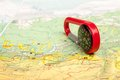 Pocket compass an image of red and road map Royalty Free Stock Images