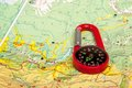 Pocket compass an image of red and road map Royalty Free Stock Photos