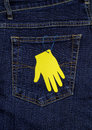 The pocket of jeans and the paper palm yellow handing at back Stock Photo