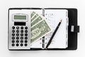 Pocket planner with pen and money Royalty Free Stock Photo