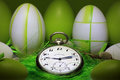 Pocket watch with easter eggs decoration Royalty Free Stock Photos
