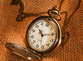 Pocket watch with gunny on the sacks Royalty Free Stock Photography