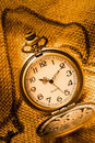 Pocket watch with gunny on the sacks Stock Images