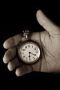 Pocket watch in hand hold look time detail duotone Royalty Free Stock Photos