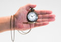 Pocket watch in hand on the white background Royalty Free Stock Photos
