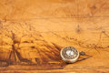 Pocket watch on old map background, vintage Royalty Free Stock Photo