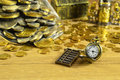 Pocket watch with pile of money still life small golden looking coins and mini abacus Stock Photos