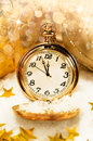 Pocket watch showing five minutes to midnight new year background Stock Image