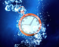 Pocket Watch in water Royalty Free Stock Photo