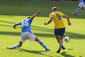 Podolski in arsenal napoli image of lukas yellow and valon behrami blue during the match for the emirates cup played Royalty Free Stock Photos