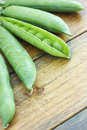 Pods cooking ingredients pea on wooden table Royalty Free Stock Photography