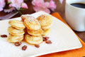 Poffertjes mini pancakes with raisins and powdered sugar Stock Image