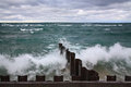 Point betsie seawall waves rolling toward the at lighthouse on lake michigan Royalty Free Stock Photography