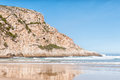 The point at natures valley is a rocky hill extending into sea mouth of groot river small town of Stock Images