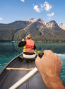 Point of view paddling a canoe gently on emerald lake in yoho national park british columbia canada Stock Images