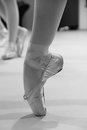 Pointe ballet bar legs crossed on in black and white Royalty Free Stock Photography