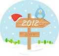 Pointer 2012 with christmas hat and bird Royalty Free Stock Photography