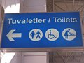 Pointer airport in turkey pokaz�vayuschyy direction to the toilet for people with ohranychenn�my abilities dropped off the Royalty Free Stock Images