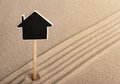 Pointer house standing in the sand can be used as background Royalty Free Stock Photography