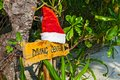 Pointer to the diving center christmas hat wooden with on island biyadhoo maldives indian ocean Royalty Free Stock Image