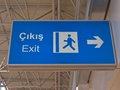 A pointer to the exit at airport in turkey blue on output Royalty Free Stock Photography