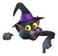 Pointing cartoon witchs cat a happy cute halloween black wearing a hat and down at your banner or sign Royalty Free Stock Photography