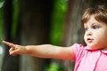 Pointing direction cute caucasian girl outdoors in park Stock Photo