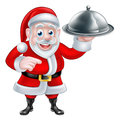Pointing Santa Chef Holding Christmas Dinner Royalty Free Stock Photo
