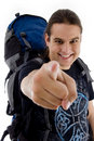 Pointing traveler with bag Stock Photos