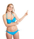 Pointing woman in bikini attractive young on on an isolated white background Royalty Free Stock Photography