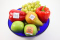 Poisoned fruits and vegetables by pestiziede fruit in a fruit bowl cut out Royalty Free Stock Image