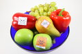 Poisoned fruits and vegetables by pestiziede fruit in a fruit bowl cut out Stock Images