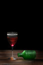 Poisoned glass of red wine closeup Stock Images