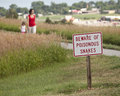 Poisonous snakes sign with people walking in background out of focus Royalty Free Stock Images