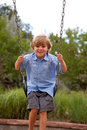 Pojkeswing Fotografering för Bildbyråer