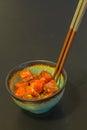 Poke lunch bowl of spicy raw tuna sushi sashimi with chopsticks Royalty Free Stock Photo
