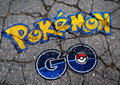 Pokemon GO logo in graffiti style on concrete Royalty Free Stock Photo