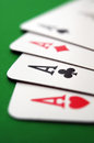 Poker aces closeup playing cards four over green table Stock Photos