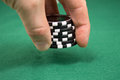 Poker bet player betting with severalchips Royalty Free Stock Images