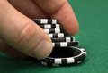 Poker bet player betting with severalchips Stock Image