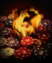 Poker cards burn in the fire Stock Photo
