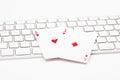 Poker cards on web keyboard Royalty Free Stock Photo