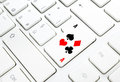 Poker casino online game concept spades hearts diamonds clubs key white keyboard Stock Photography