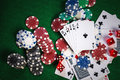 Poker chips and cards on casino gamble green table with royal fl Royalty Free Stock Photo