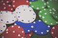 Poker chips and cards on a green table Royalty Free Stock Photo