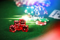 Poker Chips in casino gamble green table with colorful multi col Royalty Free Stock Photo