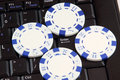 Poker chips on keyboard Royalty Free Stock Image