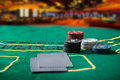 Poker chips on a poker table at the casino Royalty Free Stock Photos