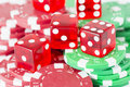 Poker chips and red casino dice close up of symbols for betting winning at Stock Images