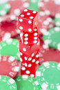 Poker chips and red casino dice close up of symbols for betting winning at Royalty Free Stock Photo